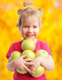 Kid with apples Stock Photos