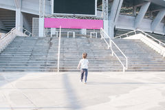 Kid approaching stairs Stock Photos