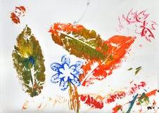 Kid art's autumn leaf paint prints Stock Photography