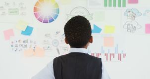 Kid as business executive looking at whiteboard 4k