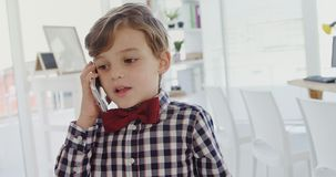 Kid as business executive talking on mobile phone 4k