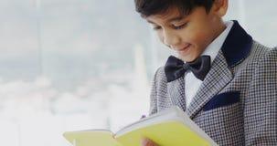Kid as businessman writing on diary 4k stock footage