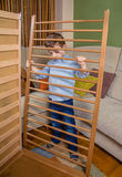 Kid assembling cot for a newborn at home Royalty Free Stock Photos