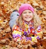 Kid at autumn Stock Photo