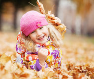 Kid at autumn Royalty Free Stock Photos