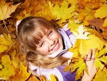 Kid in autumn orange leaves. Stock Photography