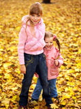 Kid in autumn orange leaves. Royalty Free Stock Images