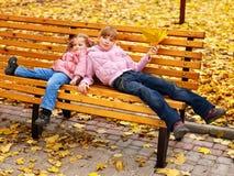 Kid in autumn orange leaves. Stock Image