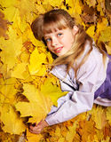 Kid in autumn orange leaves. Stock Image