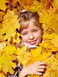 Kid in autumn orange leaves. Royalty Free Stock Photos