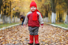 Kid in autumn park. Walk with family and smile Stock Photo