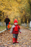 Kid in autumn park. Walk with family and smile Stock Image