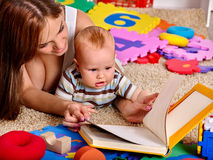 Kid baby boy with mother plying puzzle toy on Stock Photography