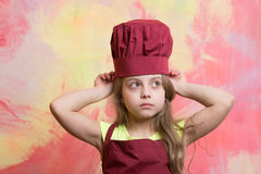 Kid or baby girl in cook or chef hat, apron Stock Photos