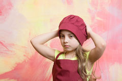 Kid or baby girl in cook or chef hat, apron Stock Photo