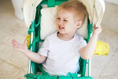 Kid in baby stroll royalty free stock images