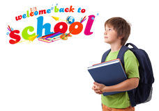 Kid with back to school theme isolated on white. Kid with books with back to school theme isolated on white Stock Photo
