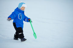 Kid on background of  winter landscape. A child in the snow. Sce Royalty Free Stock Image