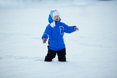 Kid on background of  winter landscape. A child in the snow. Sce Royalty Free Stock Photography