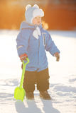 Kid on background of winter landscape. A child in the snow. Sce. Ne witn baby in wintertime wonderland royalty free stock photos