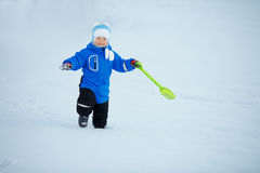 Kid on background of winter landscape. A child in the snow. Sce. Ne witn baby in wintertime wonderland royalty free stock image