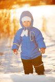 Kid on background of winter landscape. A child in the snow. Sce. Ne witn baby in wintertime wonderland stock photos
