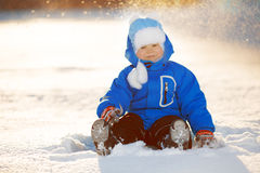 Kid on background of  winter landscape in sunset backlight. A ch Stock Photos