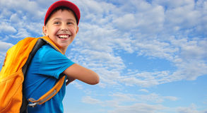 Kid with with backpack Royalty Free Stock Photography