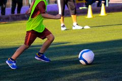 Kid with the ball at the feets stock photo