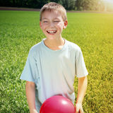 Kid with a Ball Stock Photography