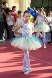 Kid ballerina in colorful dress on public stage. Nis, Serbia - April 27, 2018: Kid ballerina in colorful dress on public stage. World day of dance concept stock image