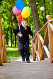 Kid with balloons Royalty Free Stock Image