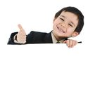 Kid with banner. Showing his thumb up stock images