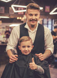 Kid at the barber shop Stock Image