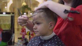 Kid in barbershop.