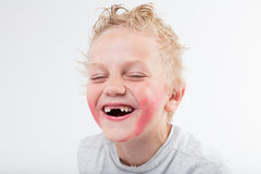 Kid baring his windowed teeth laughing stock images