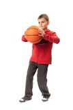 Kid with basketball Royalty Free Stock Image