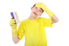 Kid with Bath Sponge. Annoyed Kid with Bath Sponge and Rubber Gloves Isolated On The White Background stock photos