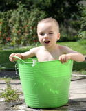 Kid bathing Stock Photo
