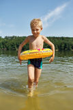Kid bathing with a floating ring Royalty Free Stock Images