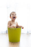 Kid bathing in a green bucket Royalty Free Stock Photo