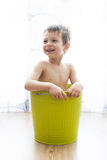 Kid bathing in a green bucket Royalty Free Stock Image