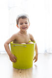 Kid bathing in a green bucket Stock Photos