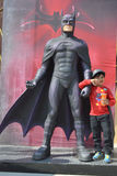 Kid with Batman statue at Ramoji film city, hyderabad Royalty Free Stock Images