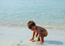 Kid in the beach royalty free stock image