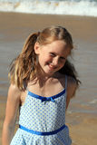 Kid at the beach. A white caucasian girl child playing on the beach on a hot summers day Royalty Free Stock Photos