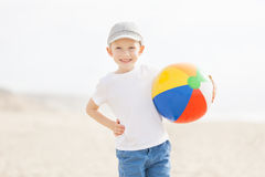 Kid with beach ball Stock Photography
