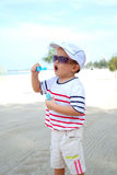 Kid On Beach Blowing Bubbles Royalty Free Stock Images