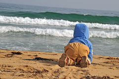 Kid on the beach crawling to the sea Royalty Free Stock Photography