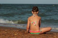 Kid on the beach, Crimea. Little girl enjoy sunshine, sea and summertime Stock Photography